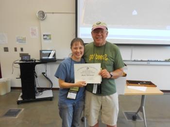 Newly certified EAS Master Beekeeper Karessa Torgerson with Dewey Caron